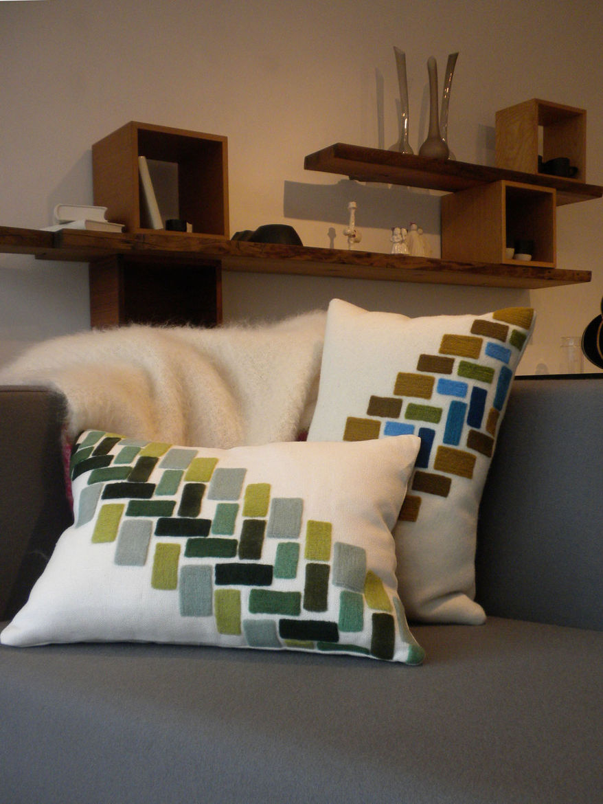 """Topping the Cubert Love Seat by <a href=""""http://www.sixoeight.com/"""">608 Design</a> is a pair of Storeys Cushions by <A href=""""http://www.kerrycroghan.com/"""">Kerry Croghan</a>."""