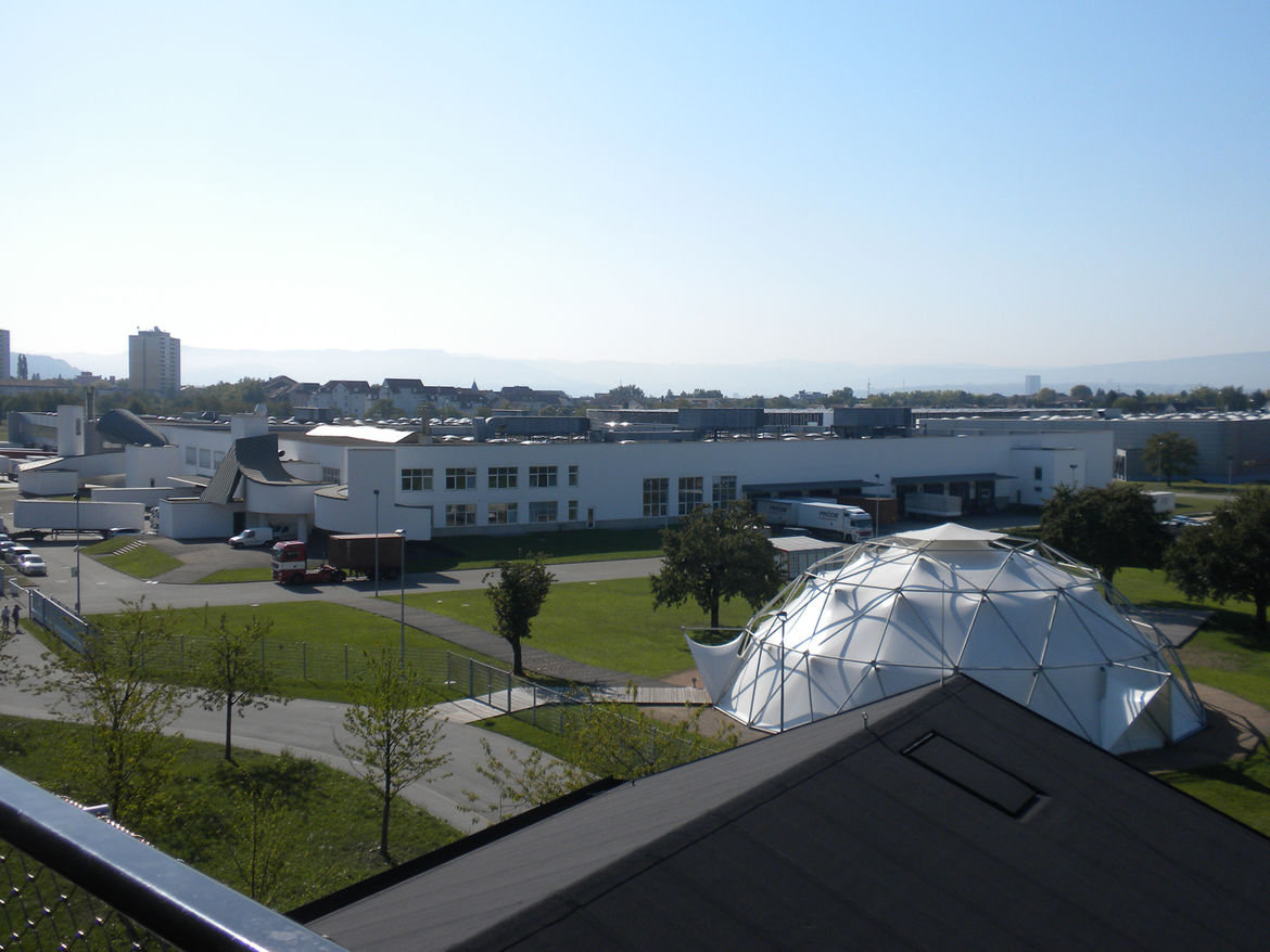 "The uppermost longhouse of the VitraHaus opens onto a balcony. This view overlooks Gehry's factory and <a href=""http://www.dwell.com/people/buckmister-fuller.html"">Buckminster Fuller's</a> Dome."