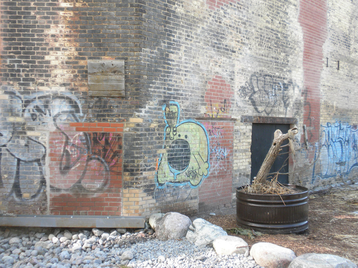 Some of the walls of the Chimney Court still bear the marks of decades of neglect. Here, as in the Welcome Hut, rather than wash away the graffiti, Evergreen has embraced it.