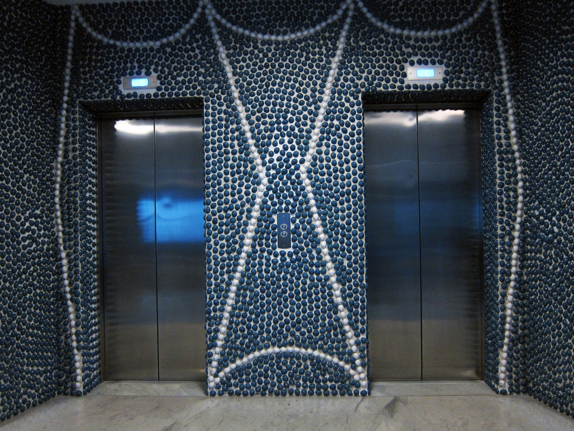 Although the elevators' interiors were one of the few things to be upgraded in a recent renovation, Ponti's elaborate graphic designs for the ceramic pebble surfaces remain intact.