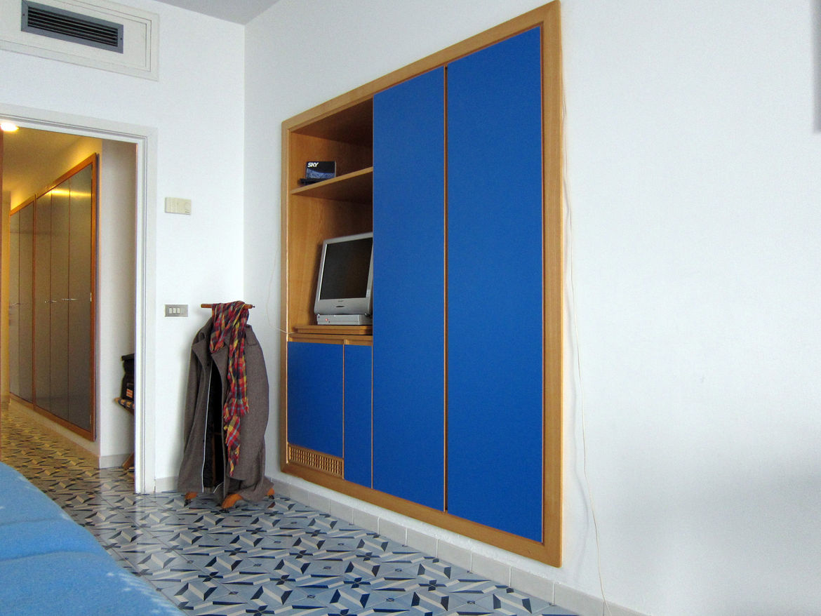 Blue laminate is also featured prominently in the built-in cabinetry.