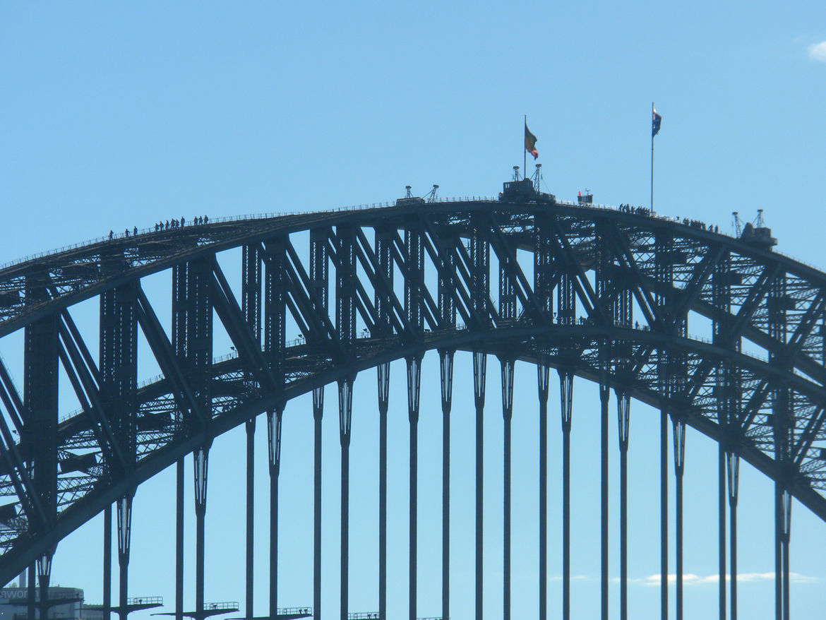 "Yes, those tiny specks are people on top of the Sydney Harbor Bridge. Since 1998, <a href=""http://www.bridgeclimb.com"">BridgeClimb</a> has lead tourists (and locals) up the magnificent structure on guided tours. We did a twilight climb, which let us take"