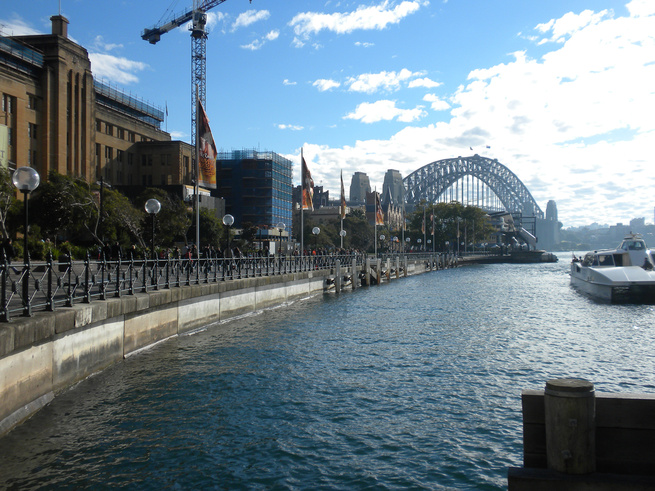 The Sydney Harbor Bridge (or Harbour Bridge as they spell it there) is one of the city's iconic landmarks. The steel structure, completed in 1932, stands 440 feet tall and stretches 1,650 feet across the Sydney Harbor. I took this photo from the west end