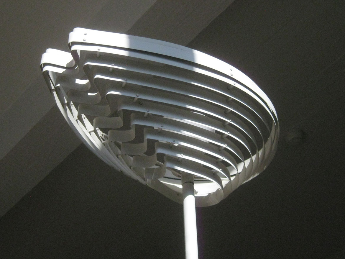 """Upon ascending the stairs to the main work area visitors are greeted by a variation of the """"Enkelinsiipi"""" (or Angel's Wing) design (A805) that is mounted on a flag pole-like base."""