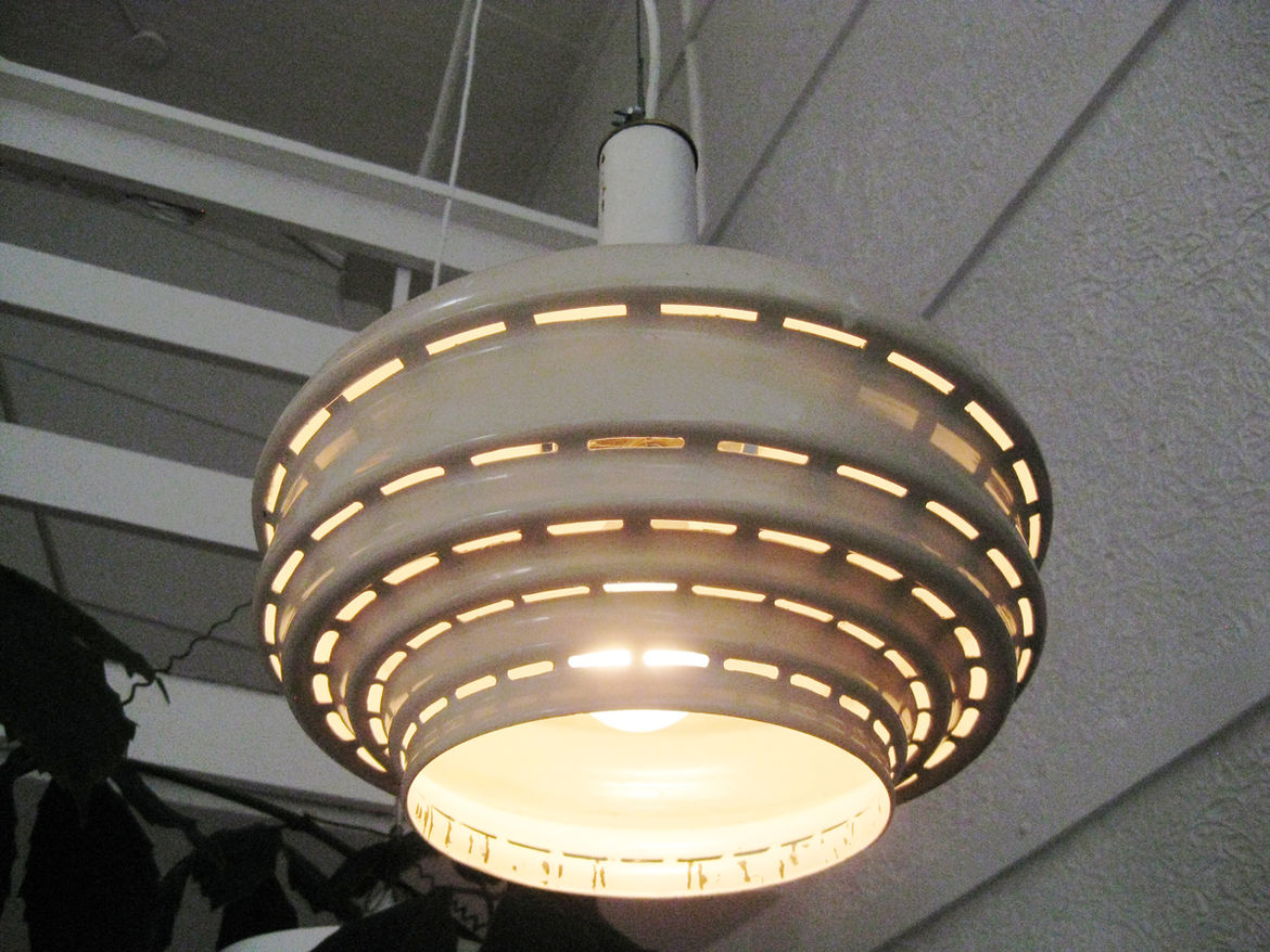 This pendant version of lamp A335 is made from white enamel. Other variations include an inner ring of brass—a detail often seen on Aalto's lighting.
