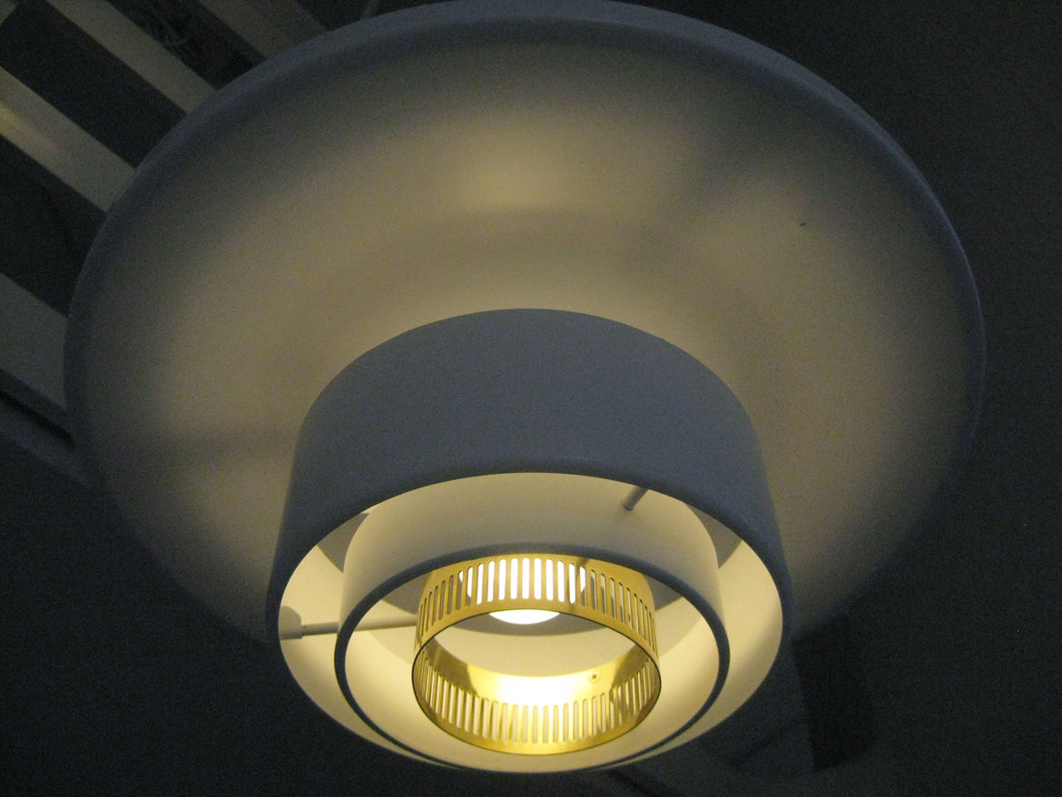 A624 is a large scale lamp capped by a large parabolically-curved reflector.