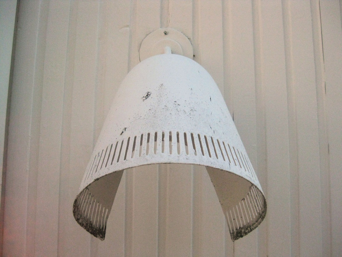 This sconce lights the home's upper terrace. When it was completed in the summer of 1936 the house would have had extensive views of the nearby bay.