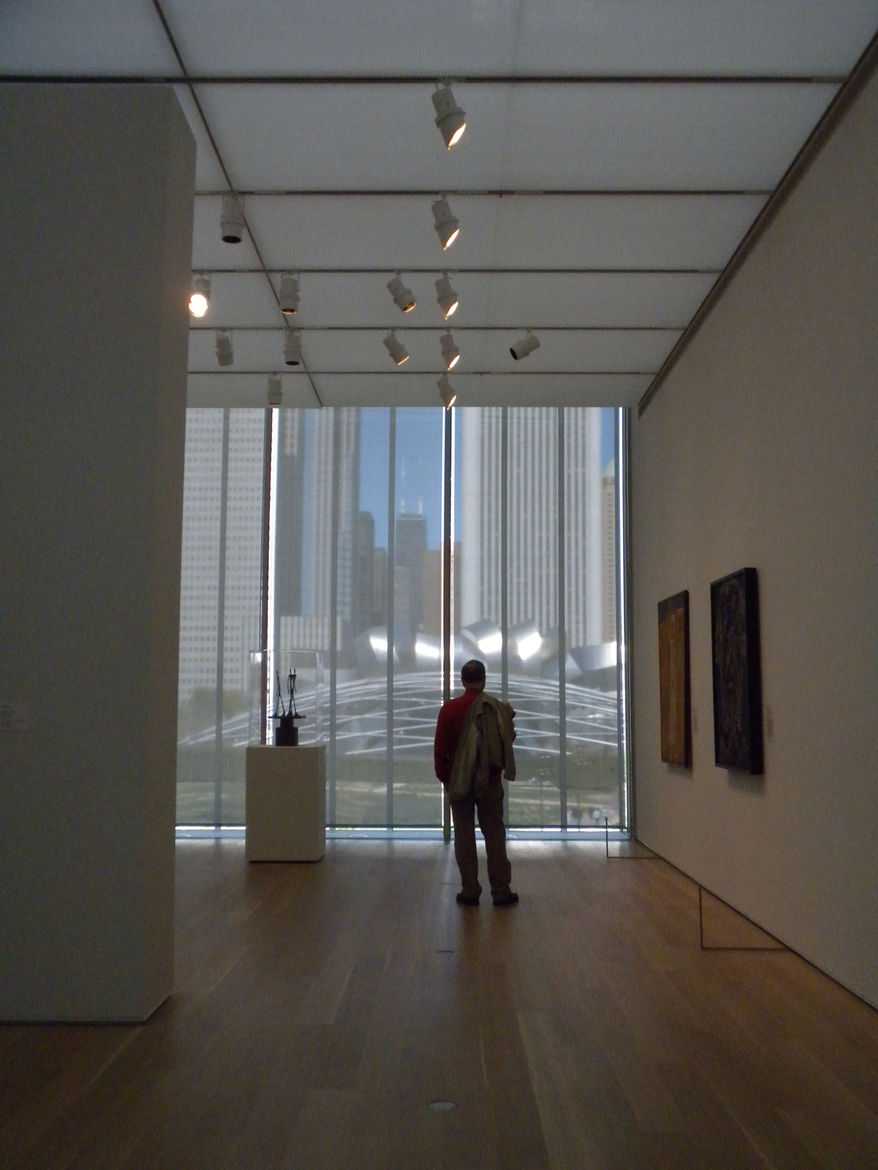 The man pictured here was not looking at any piece of art or sculpture in the gallery but instead looking past the glass to Millennium Park and the Jay Pritzker Pavilion. I loved this moment because it showed the power of architecture to frame a view and