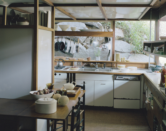 Sculptor, ceramist, and tableware designer Russel Wright built his home in Garrison, New York, in the 1950s. Design influences from Japan stemmed from a trip to Asia in 1955. The kitchen, shown here, features windows that look out upon rocks that lead up