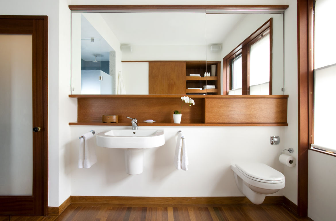 """""""Whenever you're making a minimal bathroom, you always have issues with storage,"""" Klug says. The wall-hung <a href=""""http://www.duravit.com"""">Duravit</a>sink leaves no place """"to put all your junk,"""" so Klug and Butz added small shelf above. The space to the"""