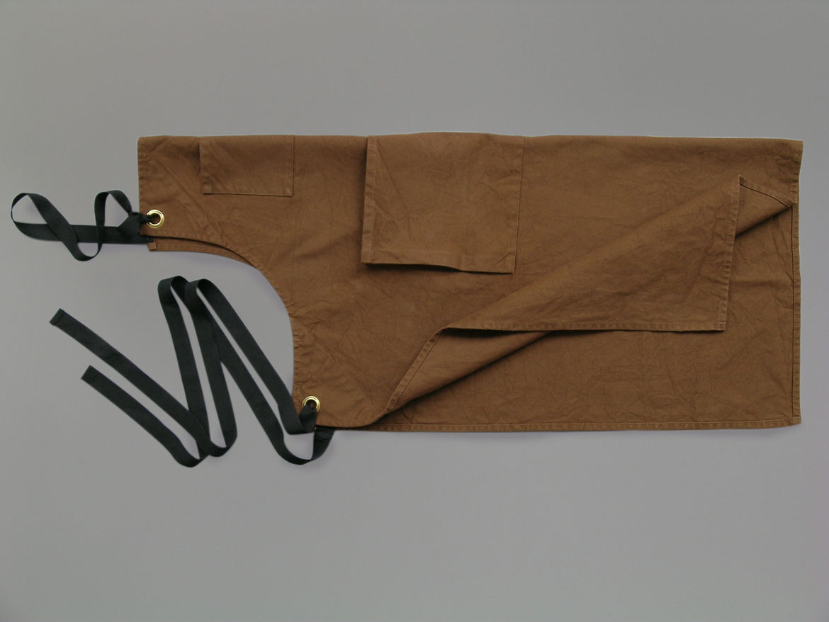 "<b>Brown Canvas Apron</b> ""We produce this apron. Made of a very functional heavy duty canvas, this apron has now been adopted by several restaurants and stores."" Photo courtesy of Labour and Wait."