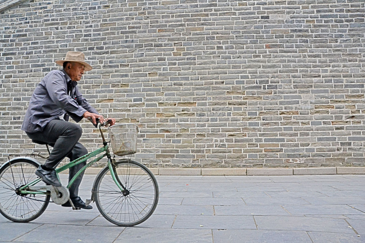 Still in Qufu, Shahid spotted this man cruising down the historic streets.