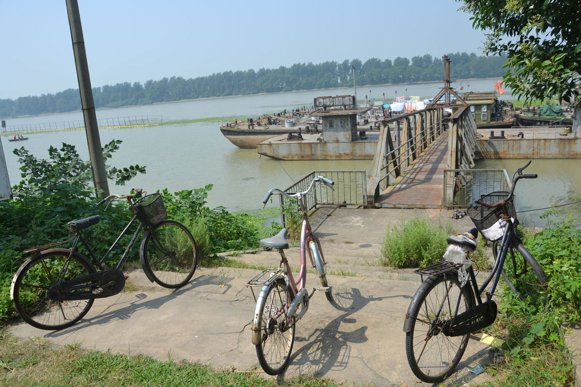 """Back on the road, Shahid biked along the Grand Canal, the largest man-made waterway in the world, which runs from Beijing to Hangzhou (south of Shanghai). """"Boats haul materials for new construction and other material goods up and down stream,"""" she observe"""