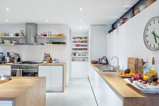 """Interior designer Kathryn Tyler's Falmouth, England, kitchen, <a href=""""http://www.dwell.com/slideshows/collectors-choice.html"""">featured in our recent June 2012 issue</a>, is a clever compromise between tight budget and calculated splurges. Furniture maker"""