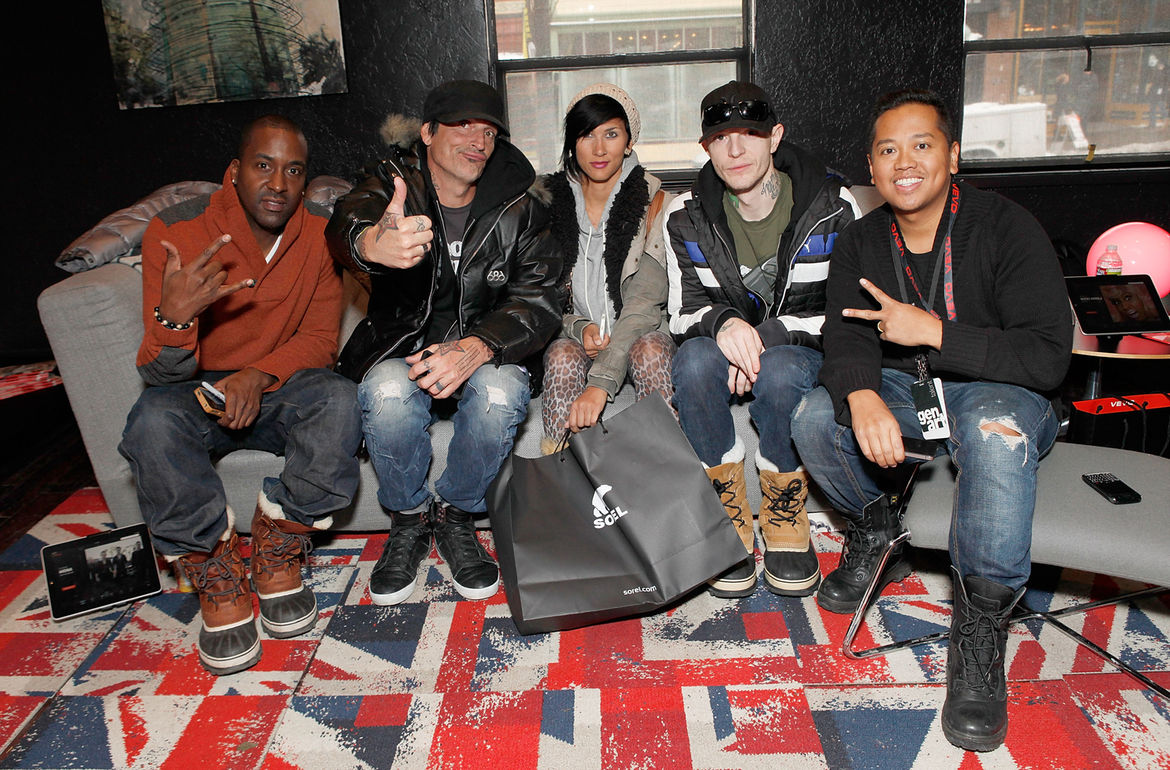 Musicians Tommy Lee (second from left) and Deadmau5 (second from right) repose on a Soho sofa from Poliform in the Vevo Powerstation end of the lounge.