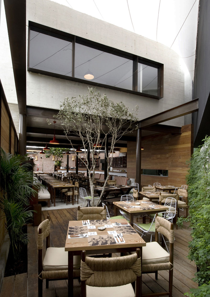 """The first-floor space between the two second-floor structures creates one of two dining patio. """"The chef wanted a fresh space that would basically be like an open market,"""" Ortiz de Zevallos says."""