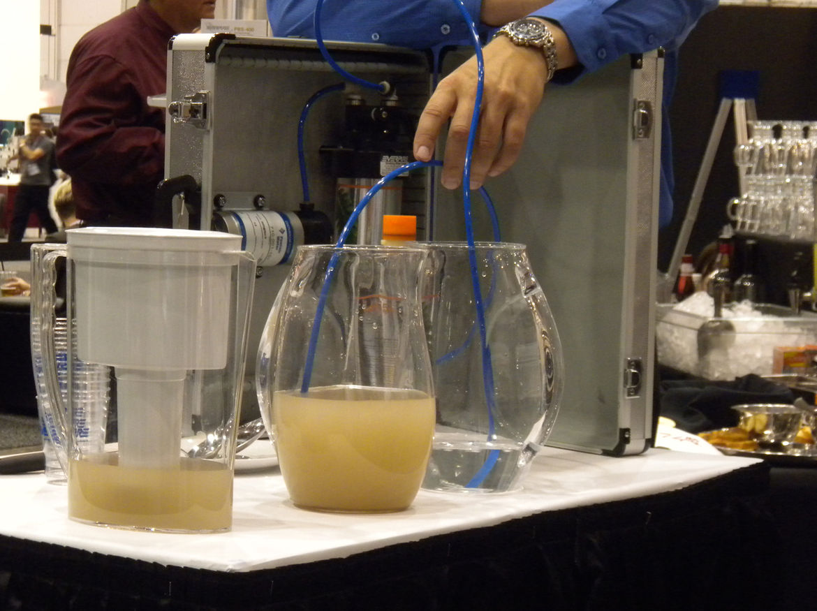 """Few things draw a crowd like a demonstration. <a href=""""http://www.everpure.com/Pages/default.htm"""">Everpure</a> showed the differing results of running dirty water through a standard pitcher filter versus through the Everpure undercounter filtration system"""