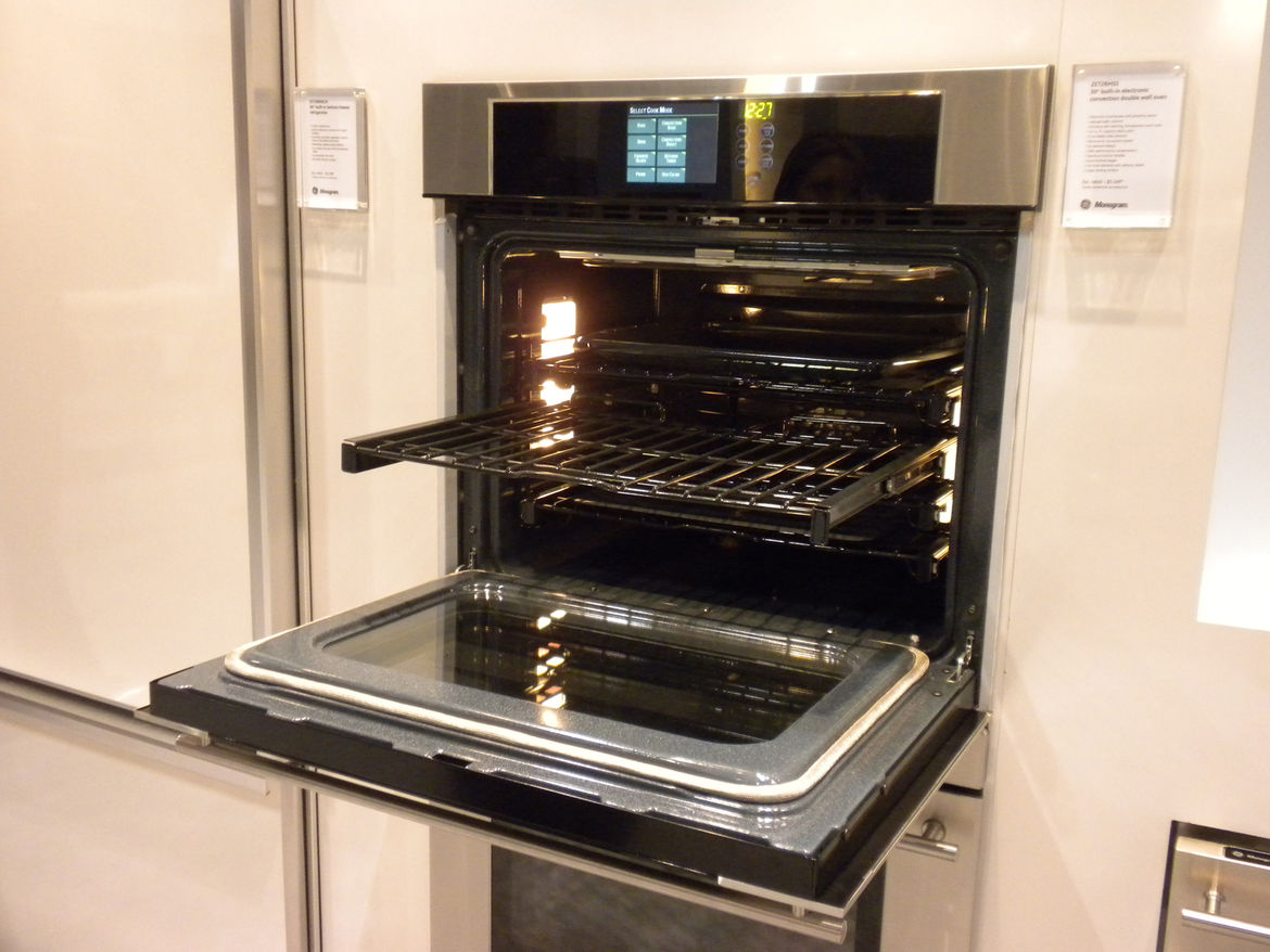 """<a href=""""http://www.geappliances.com/"""">GE</a> Monogram's ovens, like many new ovens, featured roll-out racks that extend all the way out for easier use."""