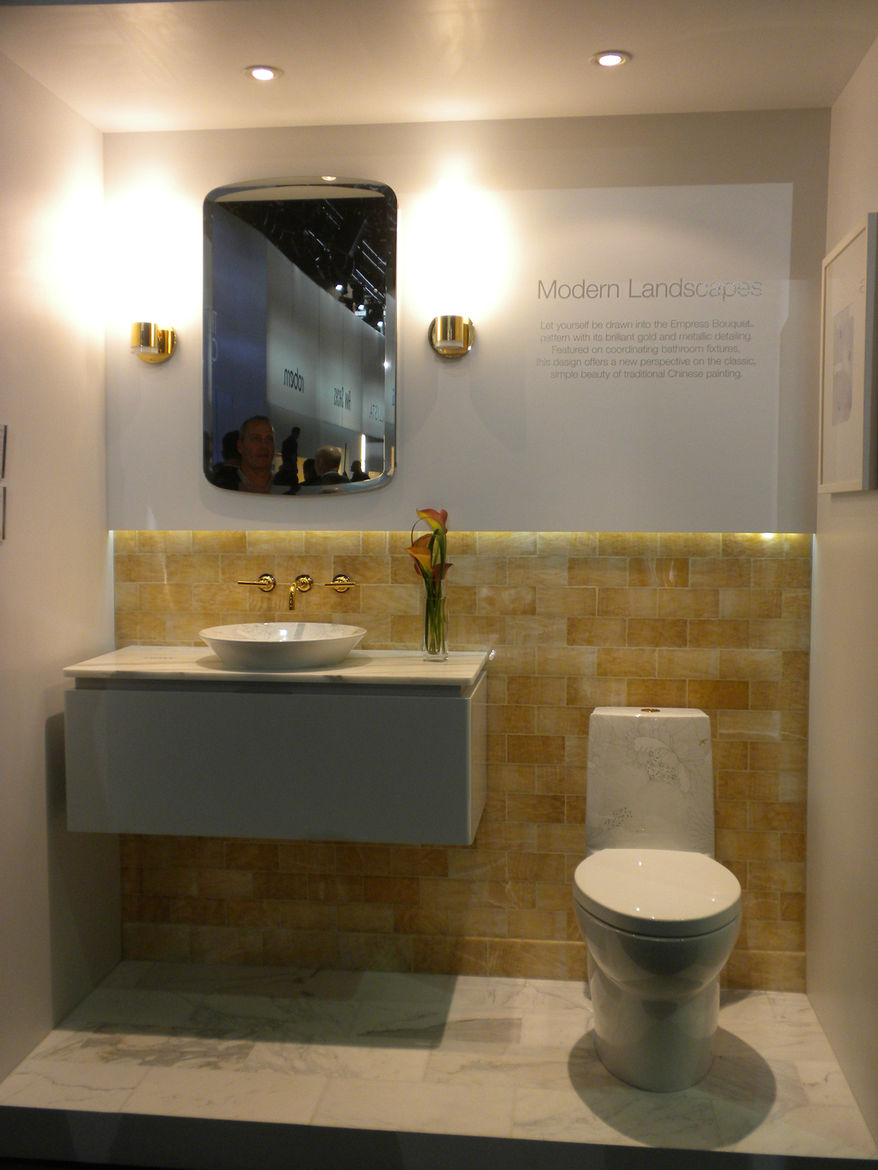 """<a href=""""http://www.kohler.com/"""">Kohler</a> introduced a new matching sink and toilet in their artist collection, which feature a light design and gold accents."""