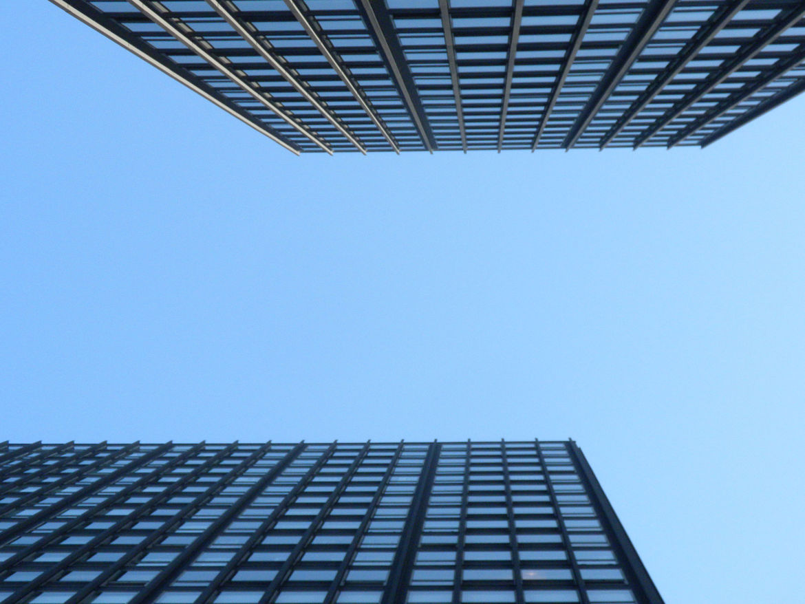 Looking up from the courtyard between the two apartment towers.