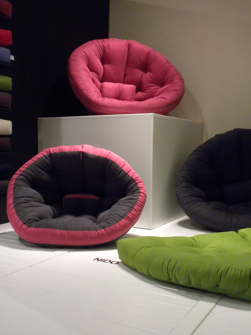 "Debuting at the show were <a href=""http://www.karup-partners.dk/sofa-beds/38-nest--nido/"">Karup</a>'s Nido and the slightly larger Nest chairs. These semi-circular futons lay flat on the floor, offering a space on which to sprawl, or fold into a ground-le"