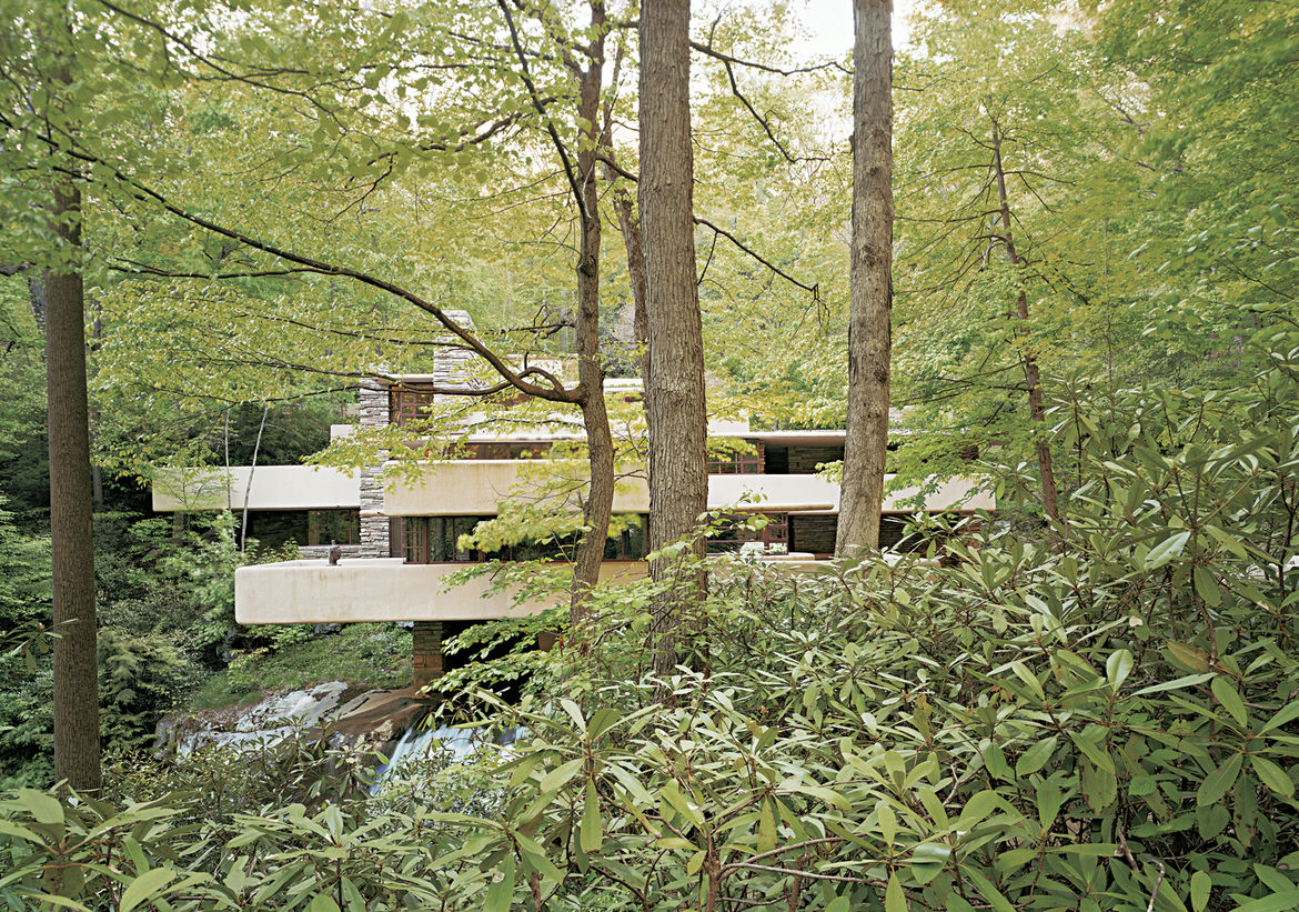 Here's another view of Fallinwater, this one emphasizing the laterality of the Prairie Style. Wright loved to map his homes across the landscape instead of orienting them vertically, and this one does seem to creep out of the foliage and terrain. Photo by