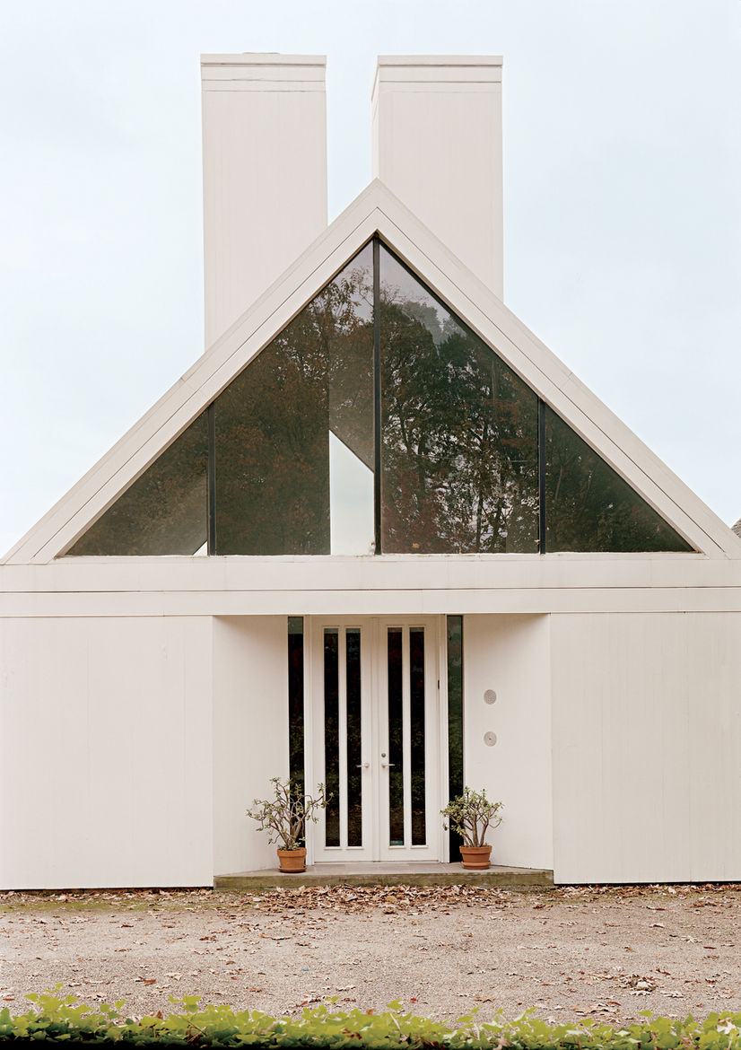 Here's the Putterman House by Hugh Newell Jacobson from 1980. This design has it all: modern lines, post-modern adoption of varied forms and reference points, and a very American fascination with rural working buildings. If a house is meant to echo a face