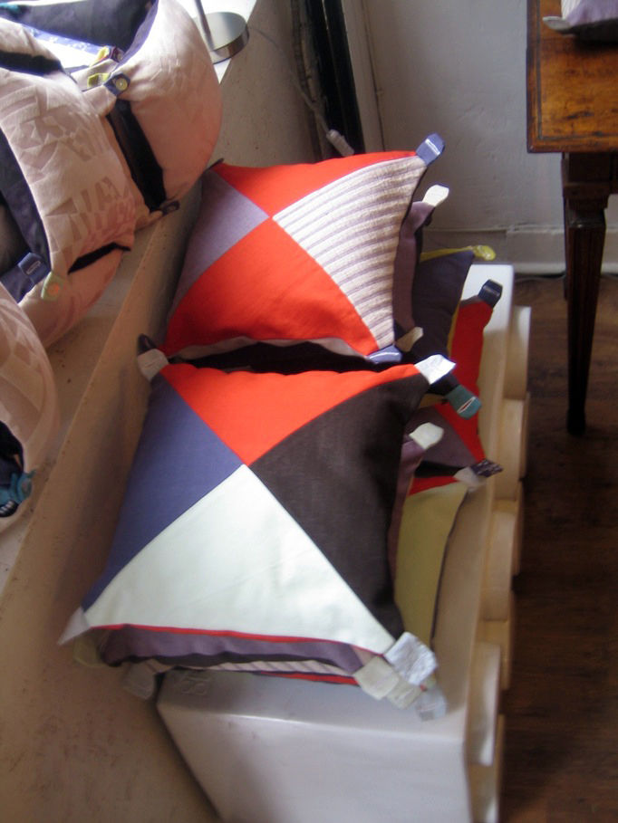 """The design shop <a href=""""http://www.chikichic.co.uk/"""">Chiki Chic</a> on Leonard St. was showing a handful of new textile and pillow designs. My favorite was this series by Mela B. called Soft Symphony. Each is different from the next, and they button toge"""