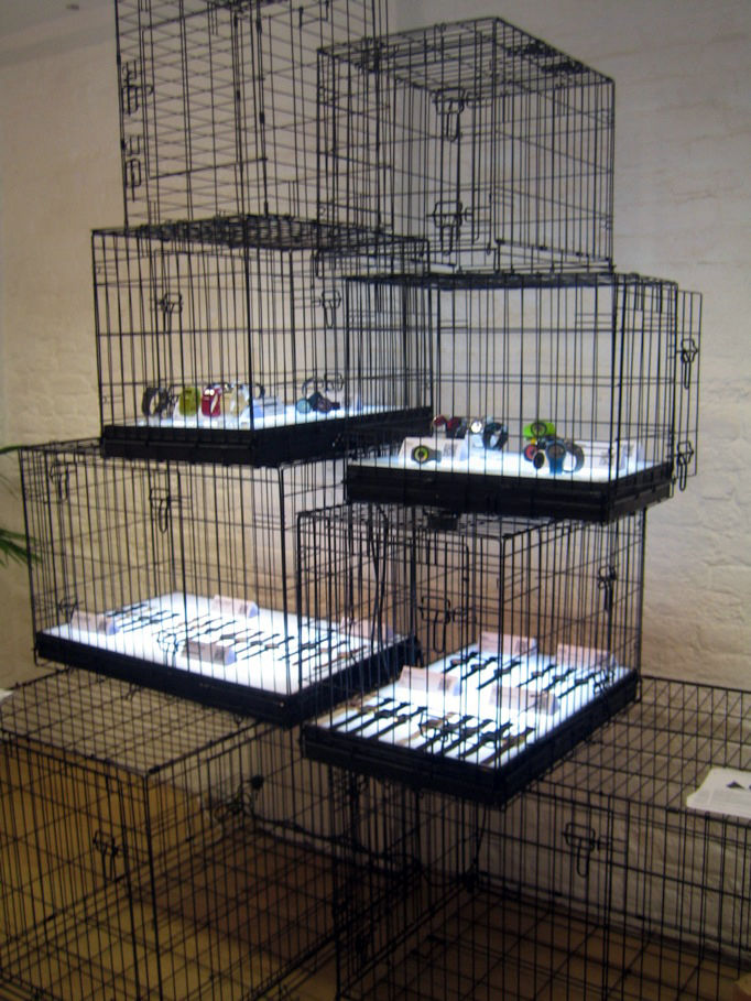 """The <a href=""""http://www.dezeenwatchstore.com/"""">Dezeen Watch Store</a> is a great spot online to pick up a new timepiece, and here at the Dezeen Space they were showing off their wares. I'm not totally sure why they were laid out in pet cages, but I suppos"""