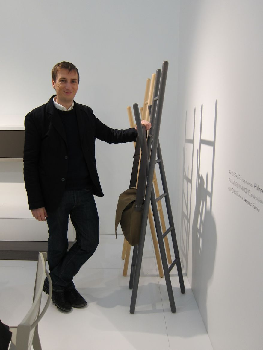 """And here's Nigro himself, who generously took the time to personally walk me through his collection. """"I'm developing the concept of two pieces crossing, coming together. I like to play with accumulation."""" Here he is with his coatrack for Ligne Roset, made"""