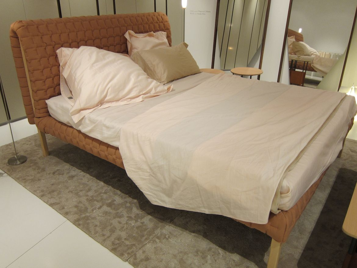 "The fabulous new Ruché bed by Inga Sempe, which can be made in almost any fabric and was exhibited in an orangey mauve. ""A beautiful bed, and a feminine one,"" said Roset."