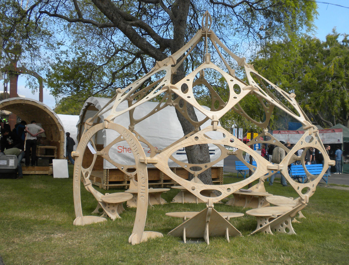 """Next to Google's big setup of shipping containers turned into shelters were a few more modest outdoor structures, such as this module wooden hut by <a href=""""http://makerfaire.com/pub/e/5245"""">Zome Builder</a>."""