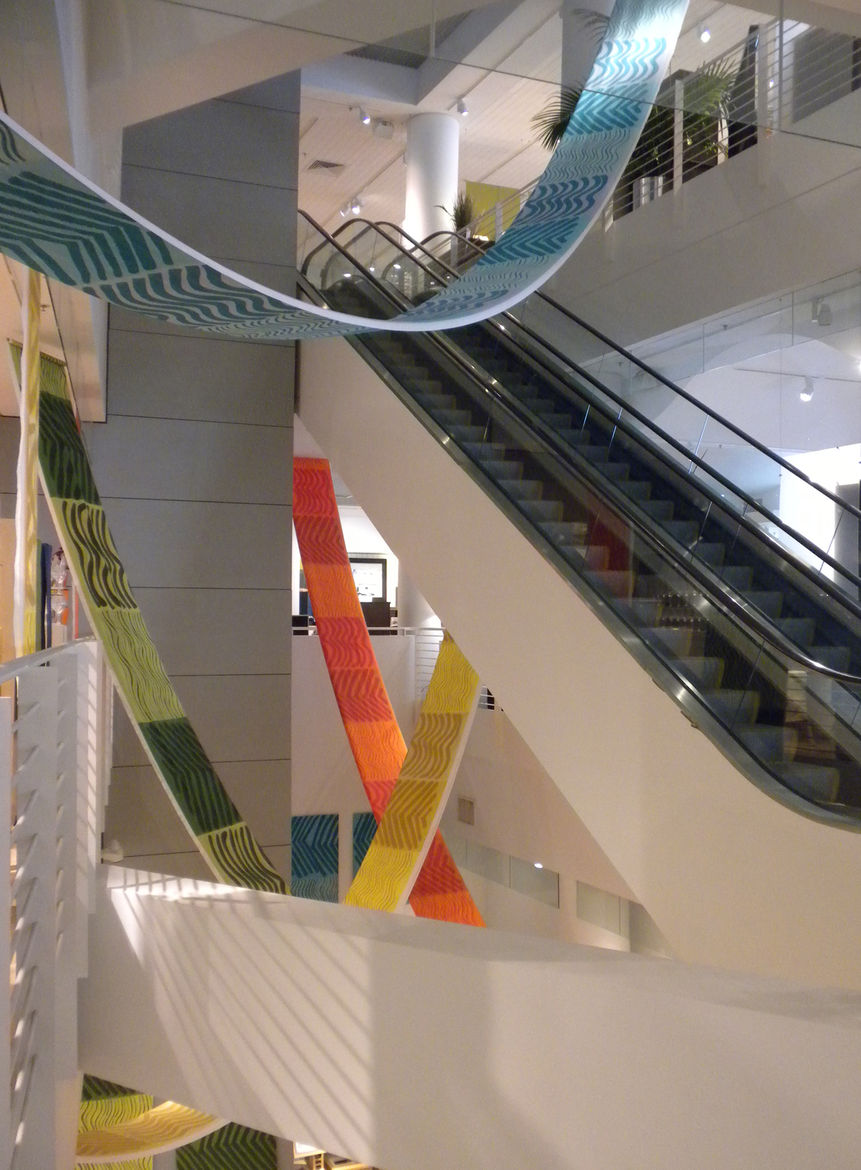 The three-level Crate & Barrel was draped with bright banners made of colorful Marimekko fabrics.