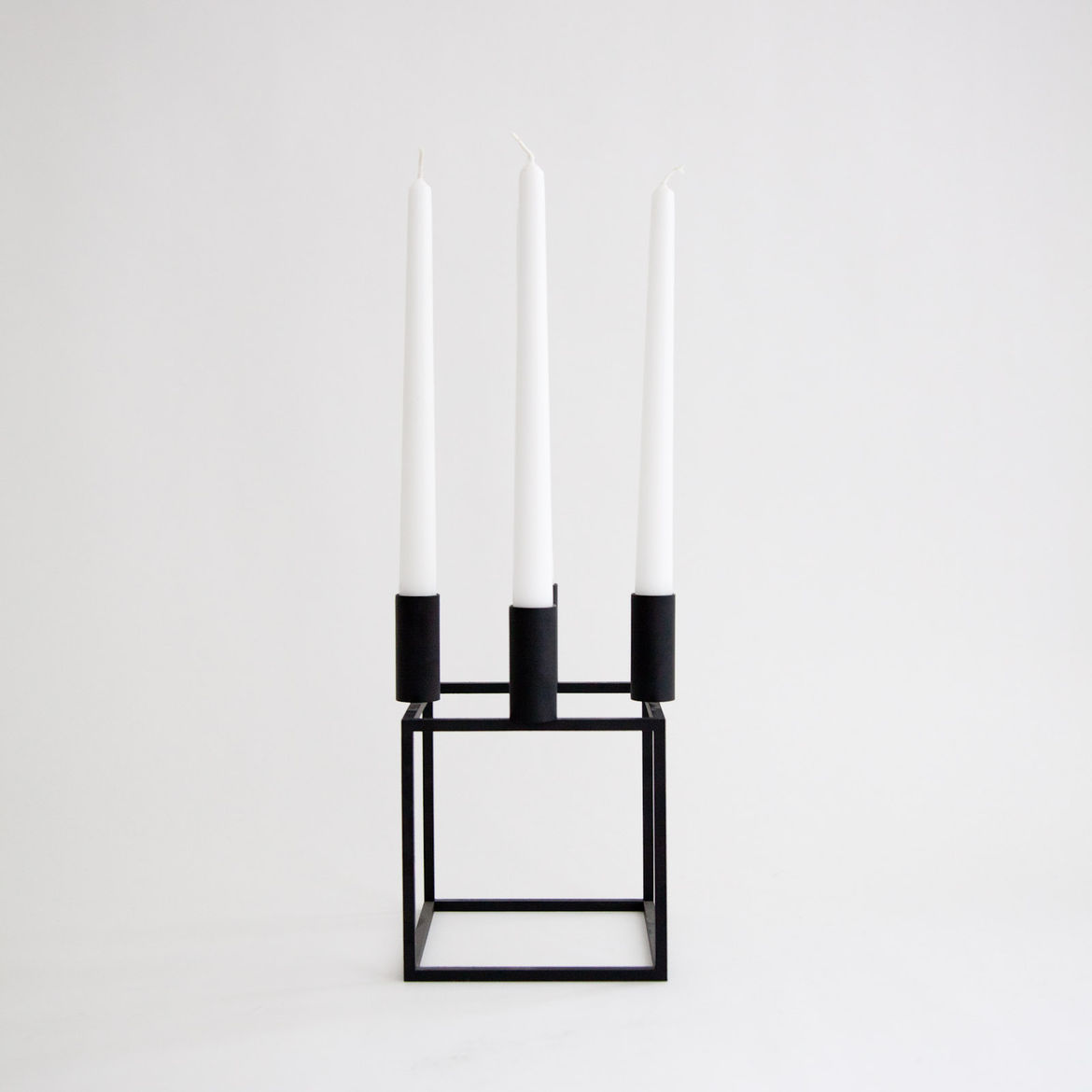 """<b><a href=""""http://store.mjolk.ca/index.php?product=10004&shop=1&search=Kubus%20Candleholder"""">9. Kubus candleholder by Mogens Lassen.</a></b> """"One of our favorite Danish design pieces, it's timeless, mathematical, and looks good anywhere. For us it's a ma"""