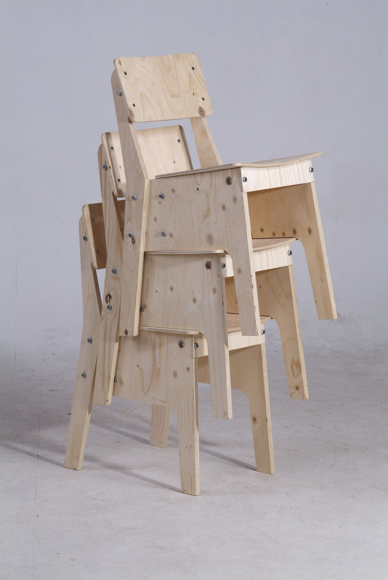 Crisis Chair in nude plywood, stacked.