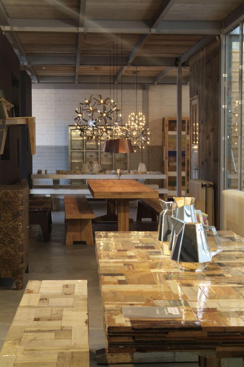 Showroom featuring Waste Table in high-gloss lacquered scrapwood