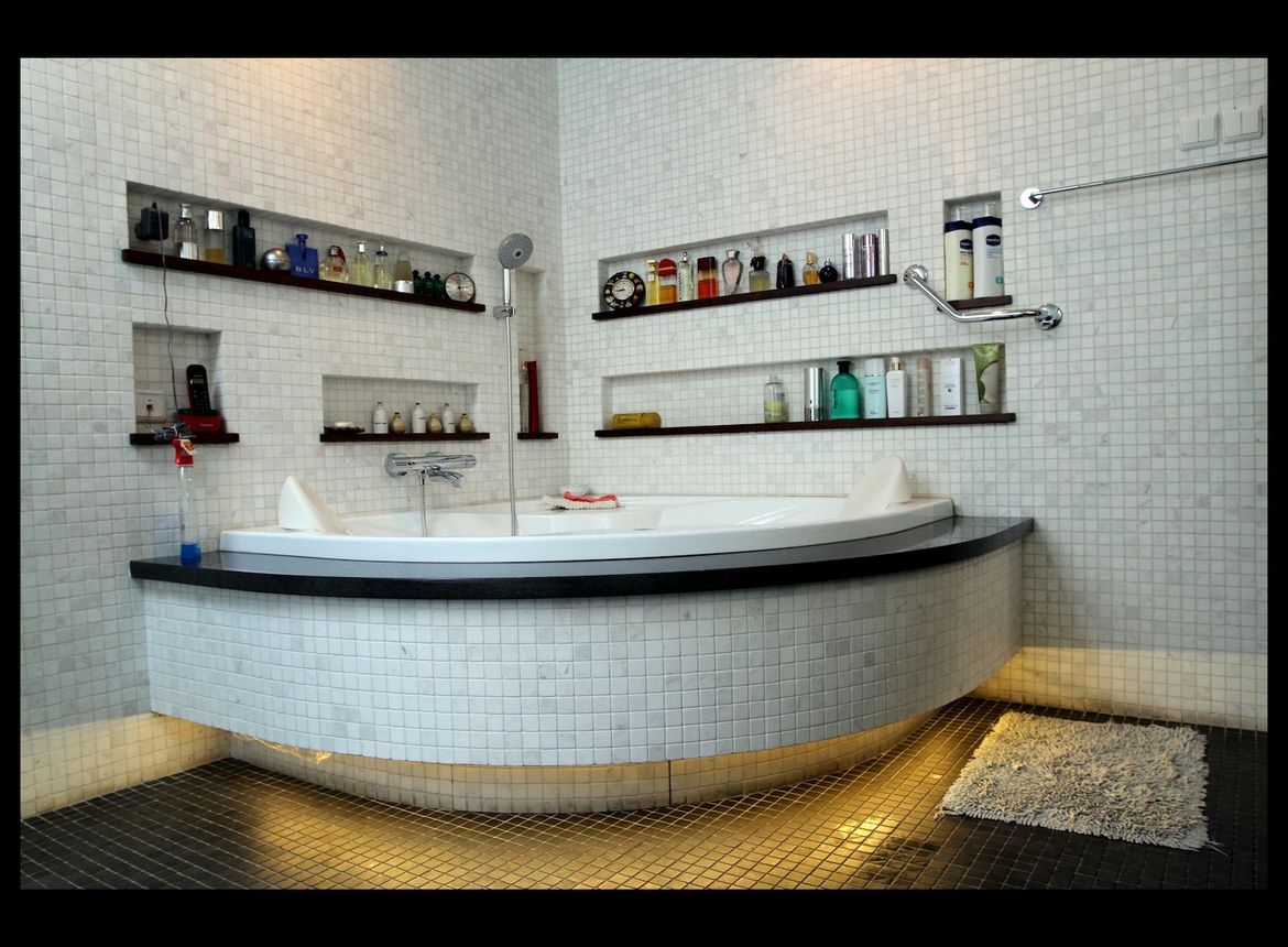 The bathroom is finished with a custom-made natural white and black marble mosaic.