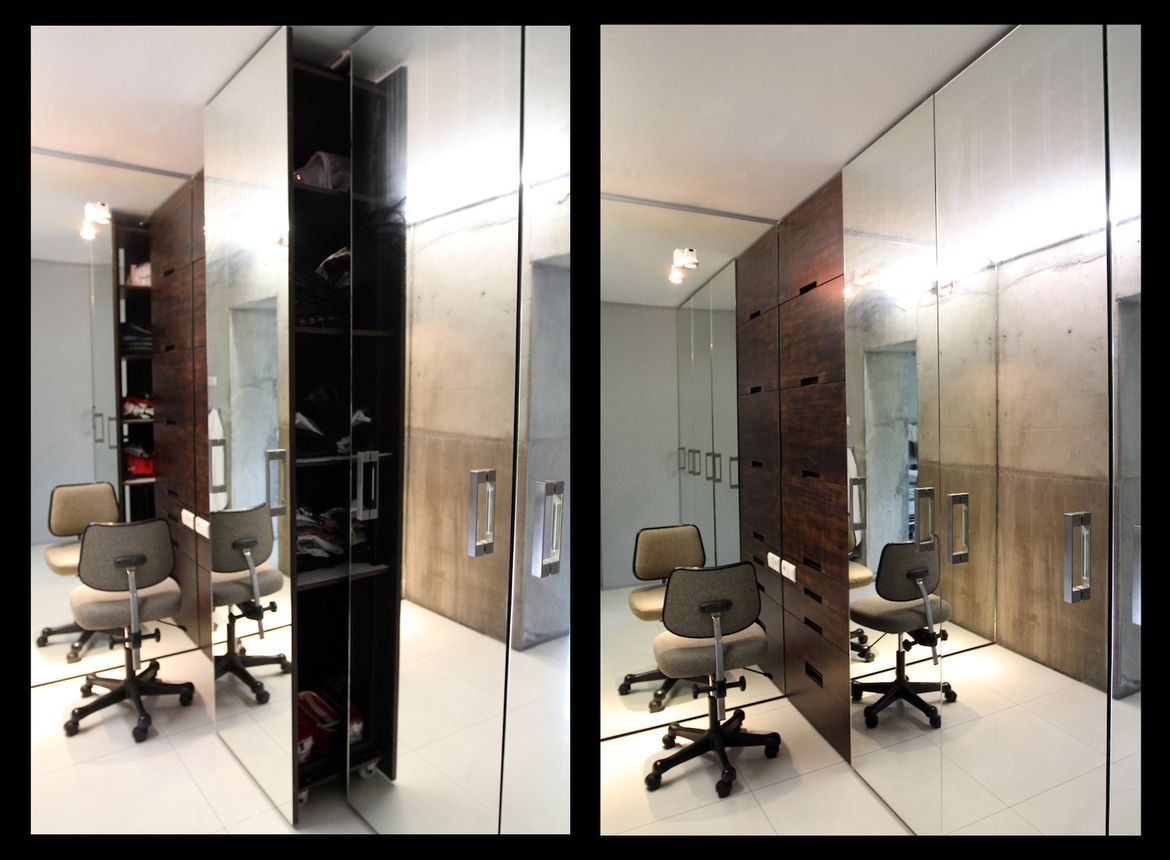 The walk-in closet is covered in mirrors, to make the space less claustrophobic.