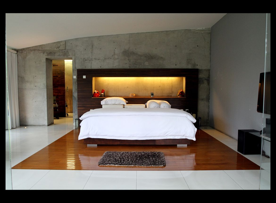 The master bedroom has a similar palette as the living room.