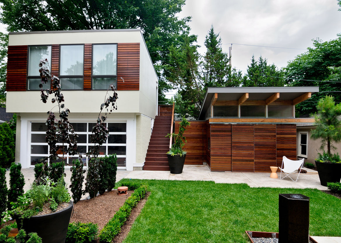 The backyard, as viewed from the kitchen, becomes a courtyard nestled between the main home and the garage and studio at the back of the property.