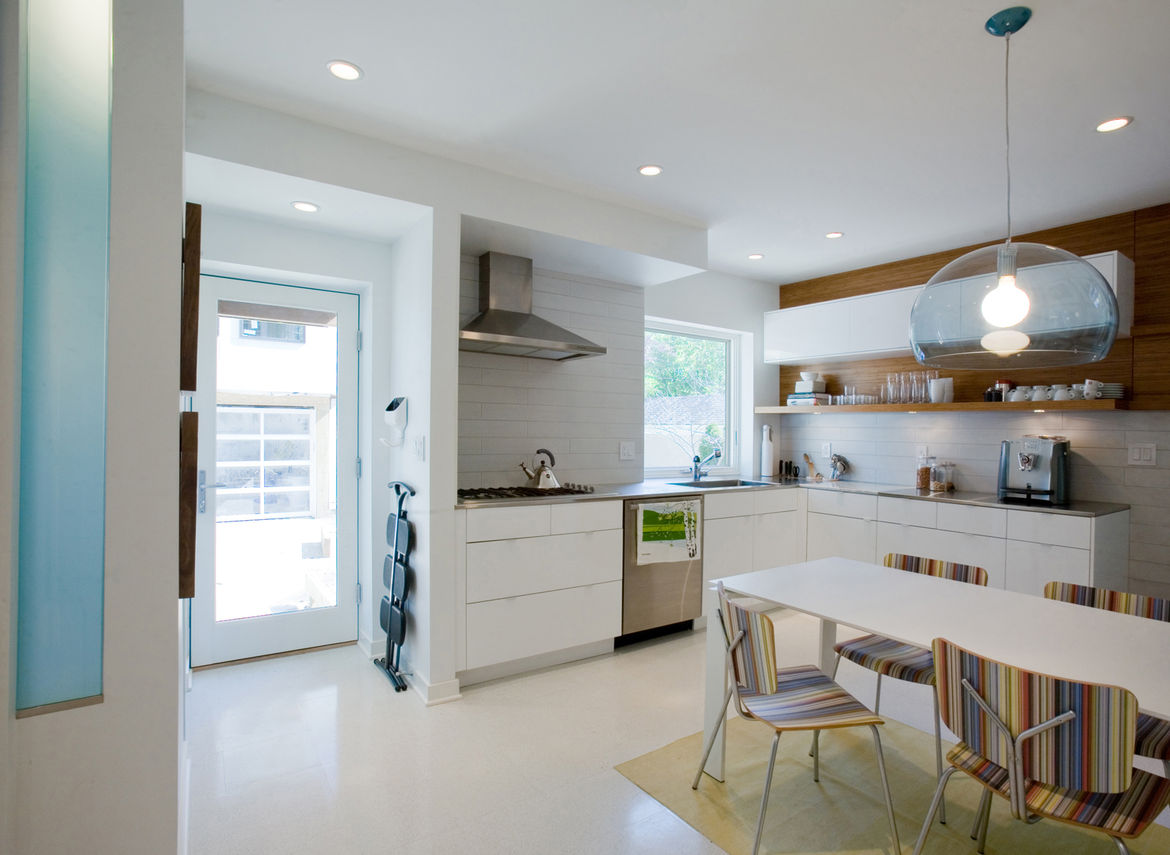 """Davison opened the wall above the sink to create a window into the backyard. """"Paetra wanted to be able to cook and do most of her kitchen activites while looking outside to see what the kids were up to,"""" she says."""