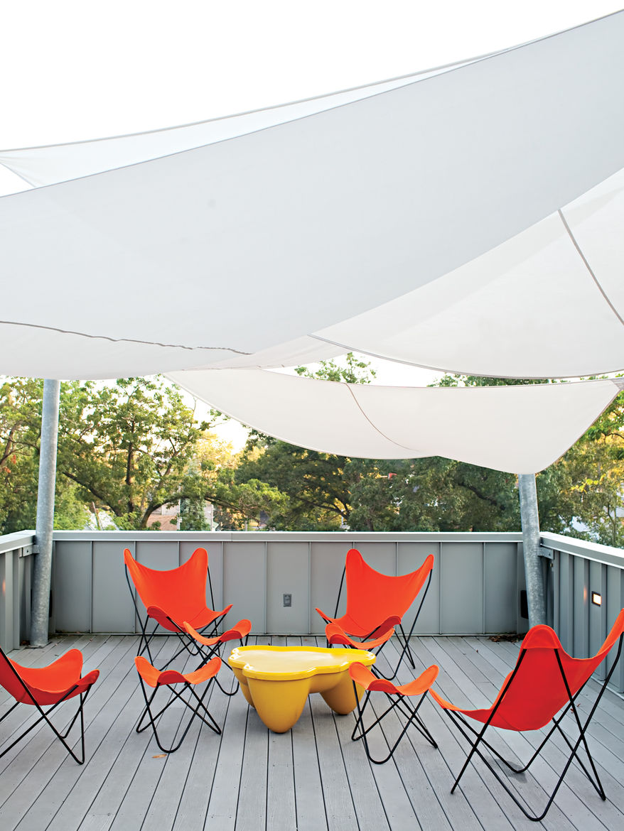 """The <a href=""""http://www.dwell.com/slideshows/come-sail-away.html"""">Church Residence</a> in Michigan City, Indiana, is topped with a generous porch equipped with a hot tub and solar sail shades fabricated by Covers Unlimited."""