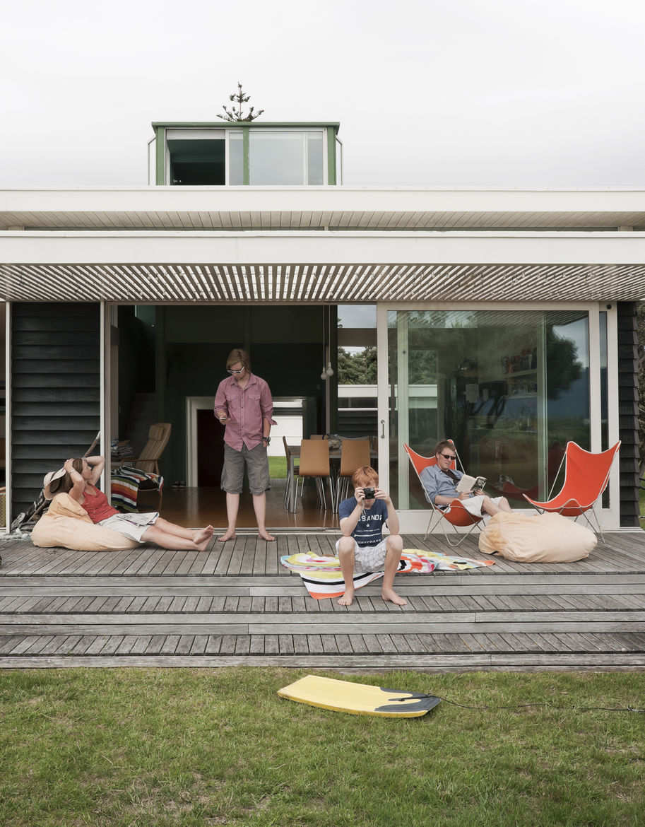 "The <a href=""http://www.dwell.com/slideshows/bach-to-the-beach.html"">Parsonson Residence</a>, a modern beach house in New Zealand, features slide-away doors and a large patio perfect for sunbathing and looking out toward Kapiti Island. (And because of the"