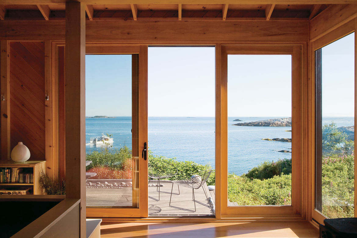 """The porch at writer <a href=""""http://www.dwell.com/slideshows/worth-the-wait-otg.html"""">Bruce Porter's off-the-grid retreat</a> on Ragged Island, Maine, boasts Leaf chairs by Arper as well as dreamy views."""