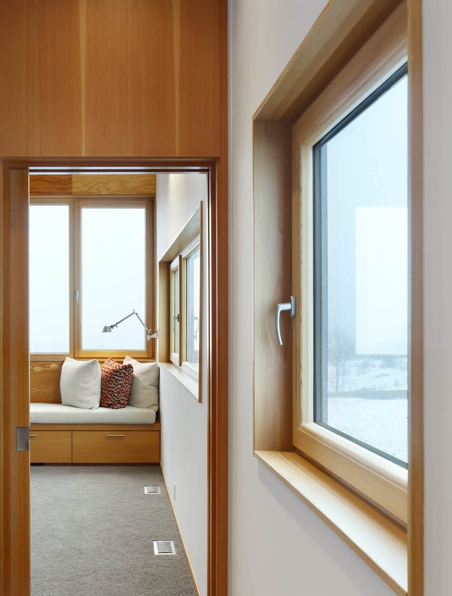 The second floor features the master bedroom and bathroom. From certain spots in the house—and on clear days—Lake Ontario can be seen in the distance (five miles away).