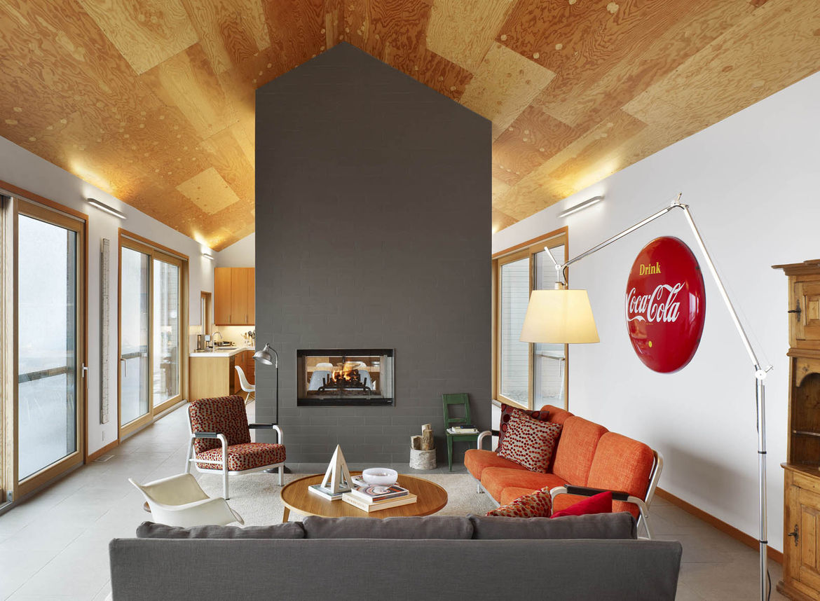 Though technically all one space, the living room, dining room, and kitchen are separated by the double-sided fireplace. When the couple comes to the house, the stay is center around relaxing, reading, walking, snowshoeing, and, in summer, swimming in the