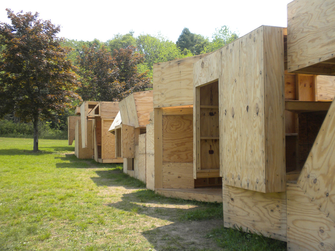 The simple palette of two-by-four lumber and CDX plywood creates a unity between each module.