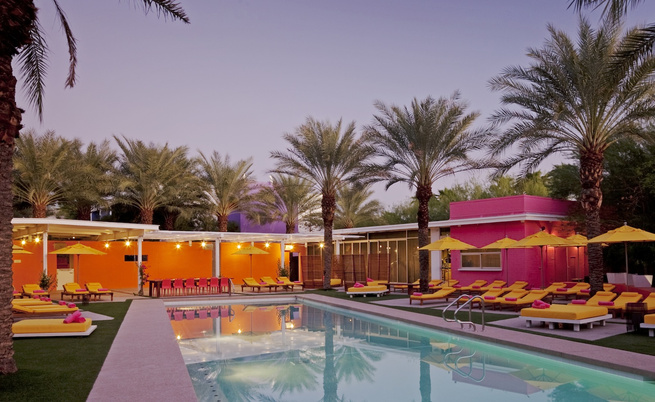 """By the """"Picante Pool,"""" the walls are painted the colors of Desert Mariposa Lily and Red Desert Globemallow. The landscaping furthers the feeling of oneness with nature, which is most evident here. The architects noted, """"Our brilliant landscape architect,"""