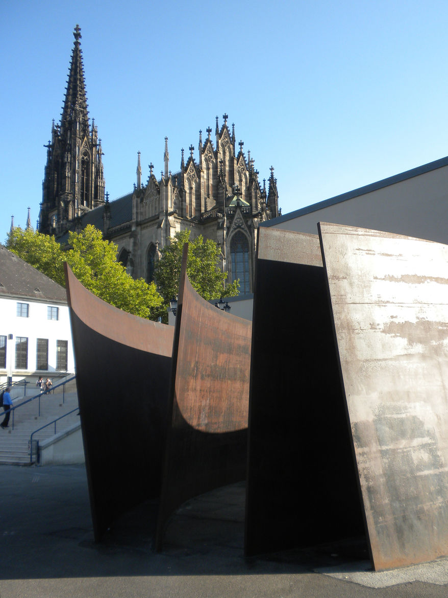 The city is filled with old beauty and in many places, it's juxtaposed with modern installations, such as Richard Serra's Intersection sculpture at the Theaterplatz with the 1865 Elisabethenkirche church in the background.