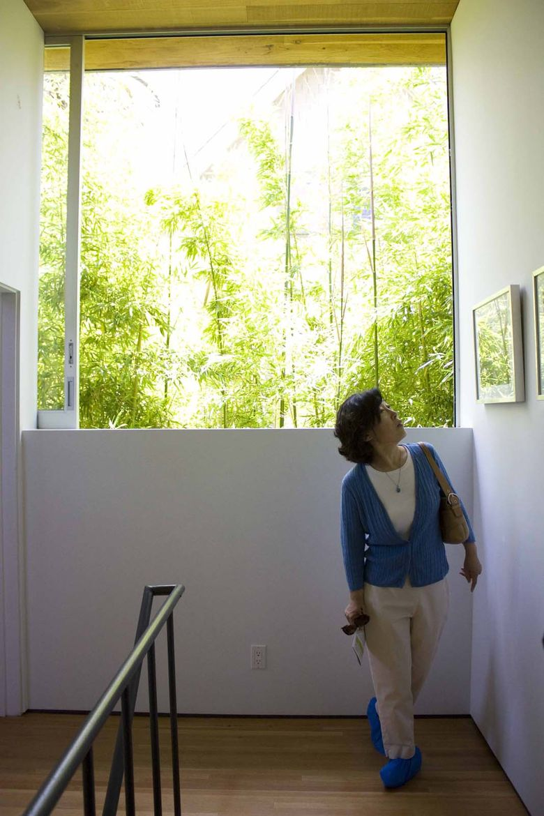 Windows create a lot of the drama in the Rose House. Each one was thoughtfully planned out and placed by architect Robert Thibodeau, says the owner.